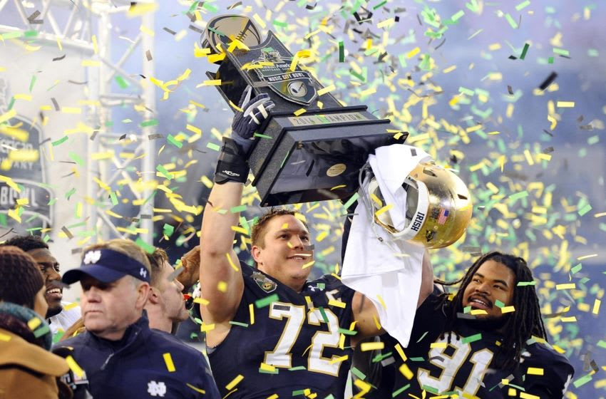 Dec 30, 2014; Nashville, TN, USA; Notre Dame Fighting Irish offensive lineman Nick Martin (72) and defensive lineman Sheldon Day (91) celebrate after winning the game against the LSU Tigers in the Music City Bowl at LP Field. Notre Dame won 31-28. Mandatory Credit: Christopher Hanewinckel-USA TODAY Sports
