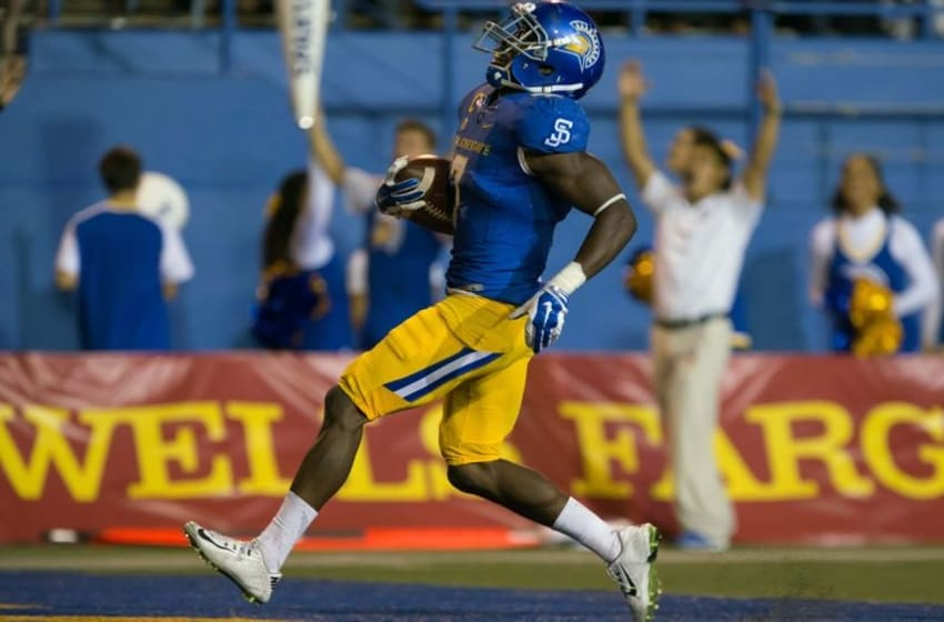 Sep 26, 2015; San Jose, CA, USA; San Jose State Spartans running back Tyler Ervin (7) scores a touchdown against the Fresno State Bulldogs during the third quarter at Spartan Stadium. Mandatory Credit: Kelley L Cox-USA TODAY Sports