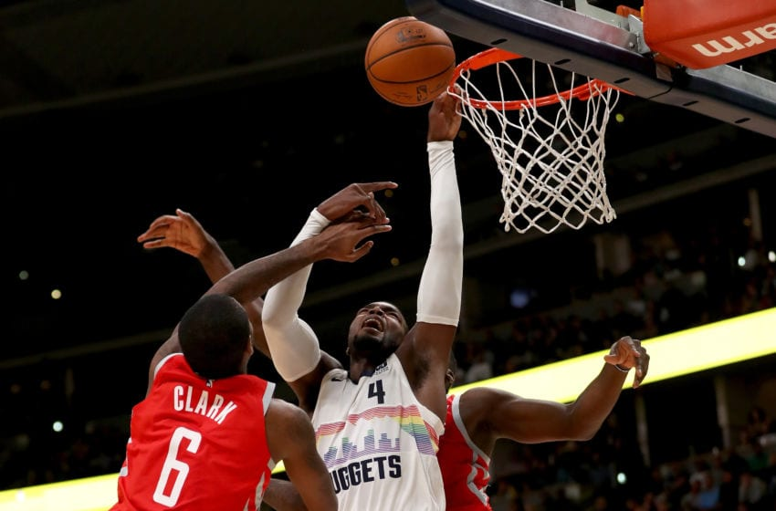 DENVER, CO - NOVEMBER 13: Paul Millsap #4 of the Denver Nuggets is blocked going to the basket by Gary Clark #6 and Clint Capela #15 of the Houston Rockets at the Pepsi Center on November 13, 2018 in Denver, Colorado. NOTE TO USER: User expressly acknowledges and agrees that, by downloading and or using this photograph, User is consenting to the terms and conditions of the Getty Images License Agreement. (Photo by Matthew Stockman/Getty Images)