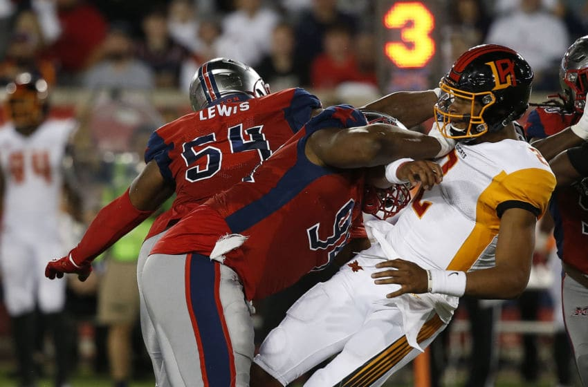 XFL Houston Roughnecks defenders LaTroy Lewis and Kony Ealy taking down Jalan McClendon (Photo by Bob Levey/Getty Images)