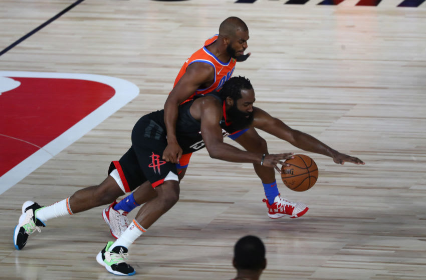 Houston Rockets guard James Harden and OKC Thunder guard Chris Paul (Photo by Kim Klement-Pool/Getty Images)