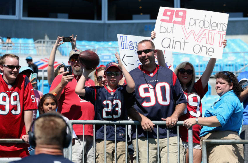 CHARLOTTE, NC - SEPTEMBER 20: J.J. Watt #99 of the Houston Texans throws a ball with fans before their game against the Carolina Panthers at Bank of America Stadium on September 20, 2015 in Charlotte, North Carolina. (Photo by Streeter Lecka/Getty Images)