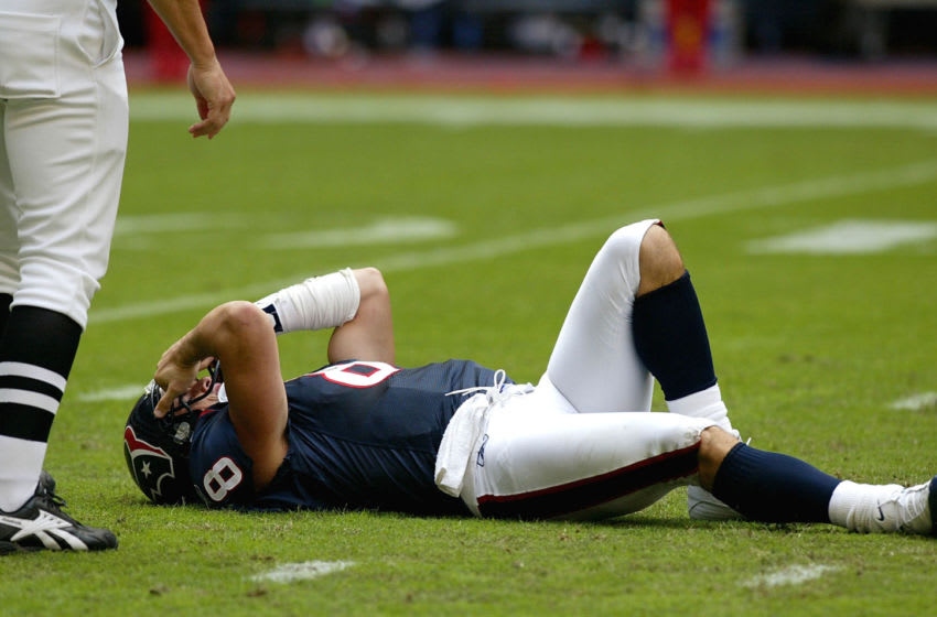 HOUSTON - OCTOBER 10: Quarterback David Carr #8 of the Houston Texans is injured during their game against the Minnesota Vikings on October 10, 2004 at Reliant Stadium in Houston, Texas. (Photo by Streeter Lecka/Getty Images)