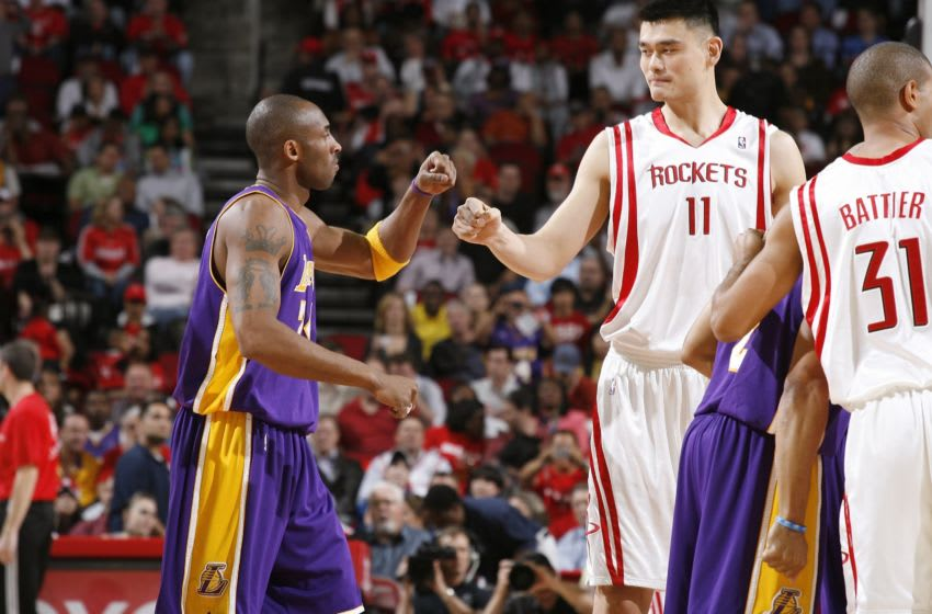 Kobe Bryant exchanging pleasantries with Houston Rockets center Yao Ming (Photo by Bill Baptist/NBAE via Getty Images)