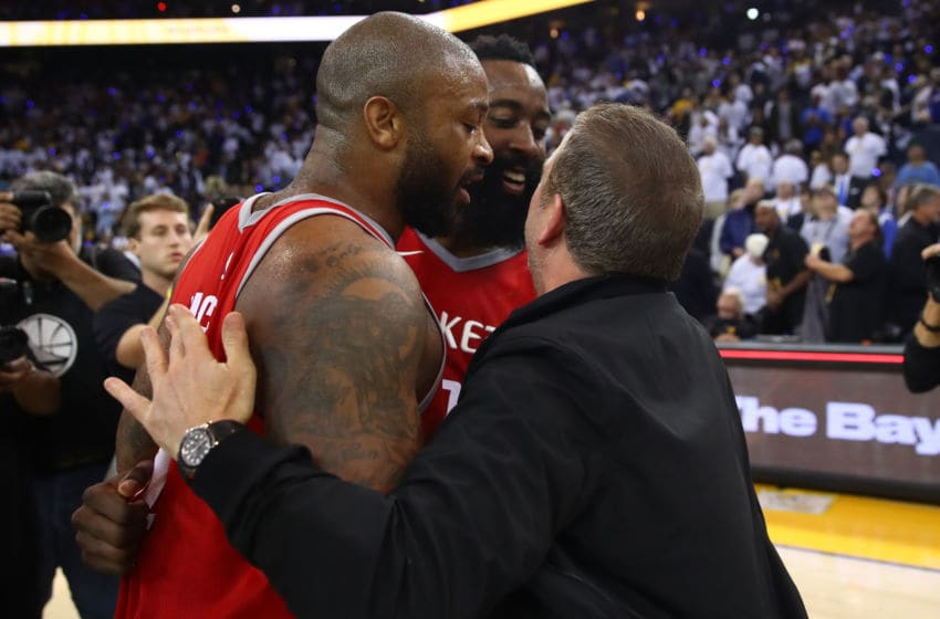 Houston Rockets guard James Harden, forward P.J. Tucker and owner Tilman Fertitta (Photo by Ezra Shaw/Getty Images)