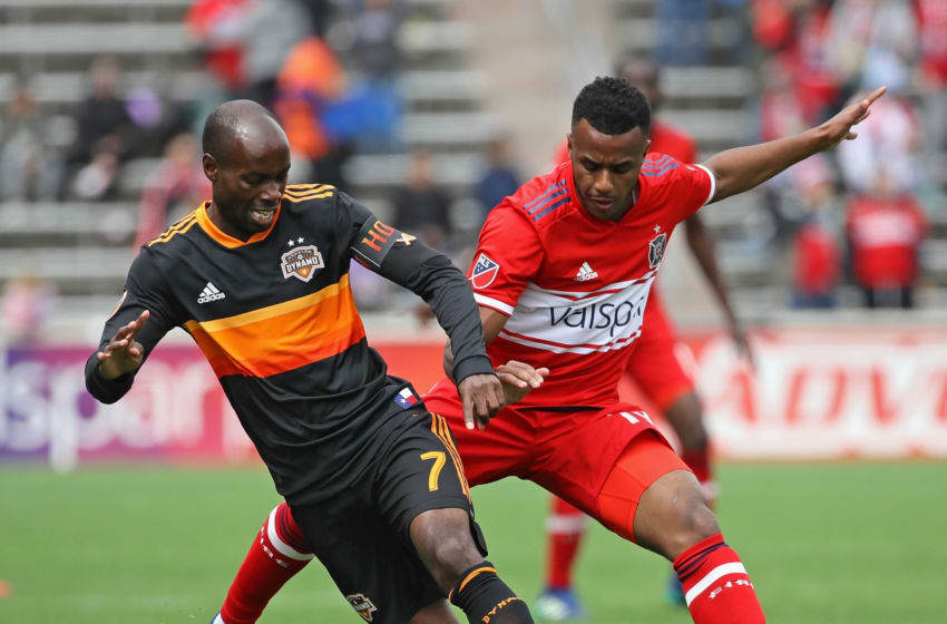 BRIDGEVIEW, IL - MAY 20: DaMarcus Beasley #7 of Houston Dynamo and Mo Adams #19 of Chicago Fire battle for the ball at Toyota Park on May 20, 2018 in Bridgeview, Illinois. The Dynamo defeated the Fire 3-2. (Photo by Jonathan Daniel/Getty Images)