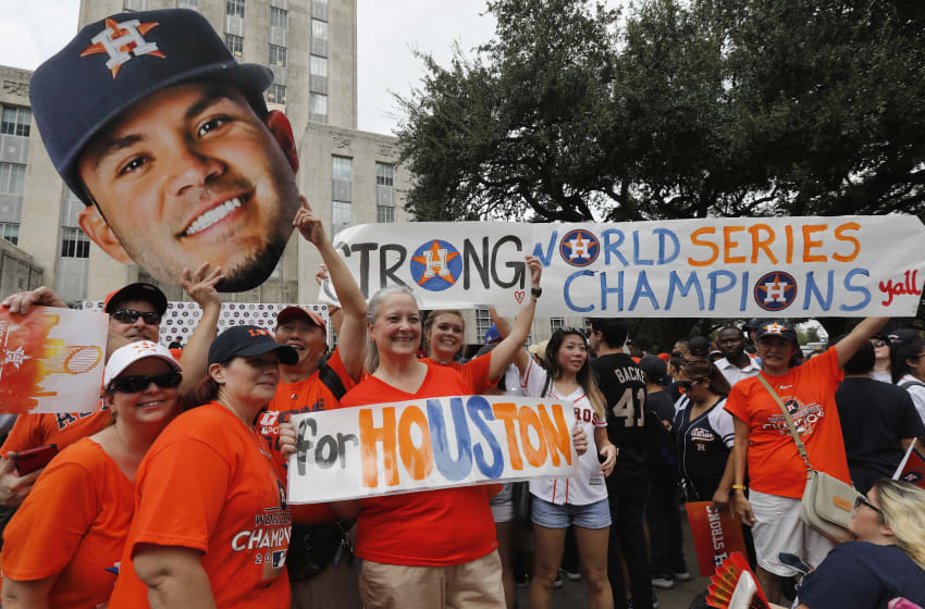 HOUSTON, TX - NOVEMBER 03: Houston Astros fans celebrate before the Houston Astros Victory Parade on November 3, 2017 in Houston, Texas. The Astros defeated the Los Angeles Dodgers 5-1 in Game 7 to win the 2017 World Series. (Photo by Tim Warner/Getty Images)