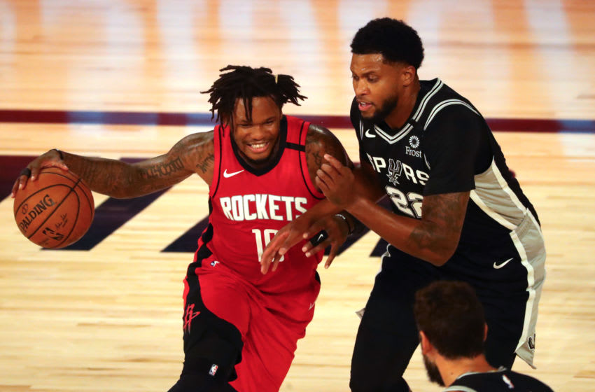 Houston Rockets guard Ben McLemore and Spurs guard/forward Rudy Gay (Photo by Kim Klement-Pool/Getty Images)