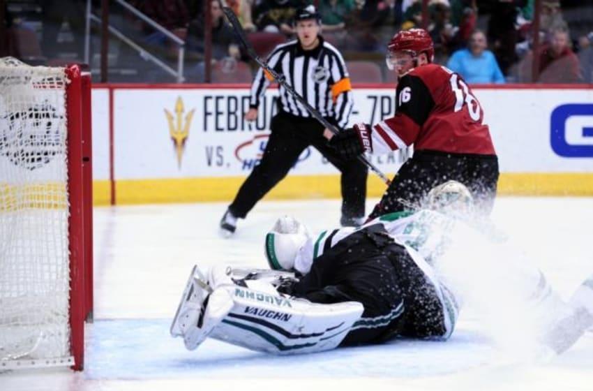Feb 18, 2016; Glendale, AZ, USA; Arizona Coyotes center Max Domi (16) scores on Dallas Stars goalie Antti Niemi (31) during the second period at Gila River Arena. Mandatory Credit: Matt Kartozian-USA TODAY Sports