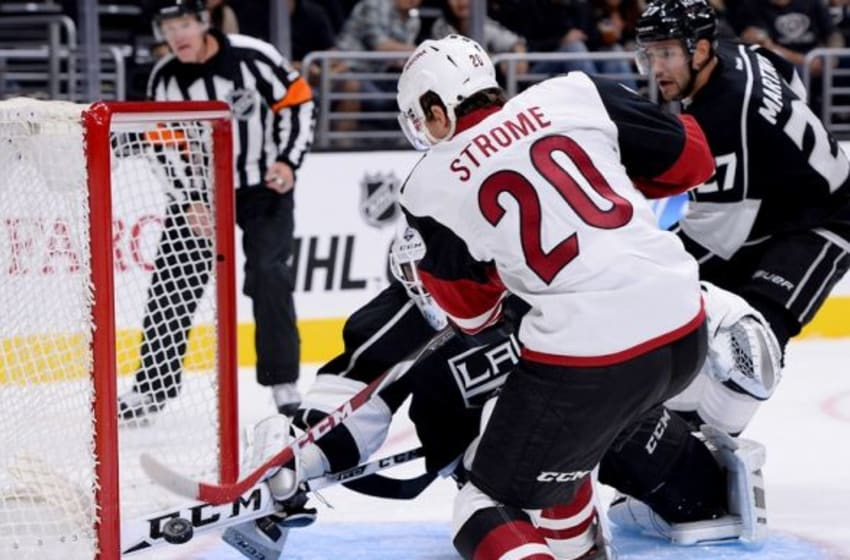 Sep 22, 2015; Los Angeles, CA, USA; Arizona Coyotes center Dylan Strome (20) scores a goal past Los Angeles Kings goalie Jhonas Enroth (1) in the first period at Staples Center. Mandatory Credit: Jayne Kamin-Oncea-USA TODAY Sports
