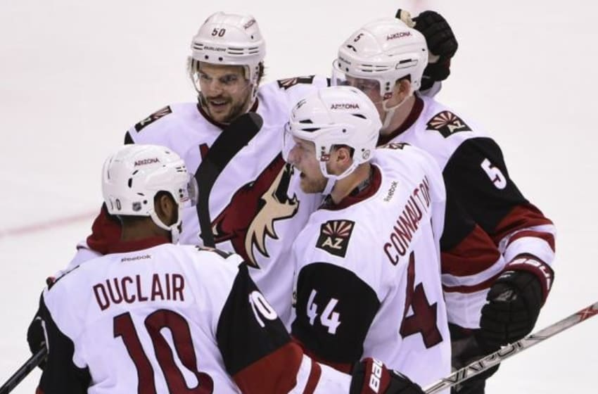 Mar 9, 2016; Vancouver, British Columbia, CAN; Arizona Coyotes defenseman Kevin Connauton (44) celebrates with teammates after scoring a goal against Vancouver Canucks goaltender Jacob Markstrom (not pictured) during the second period at Rogers Arena. Mandatory Credit: Anne-Marie Sorvin-USA TODAY Sports