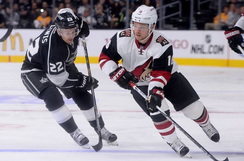 Sep 22, 2015; Los Angeles, CA, USA; Los Angeles Kings center Trevor Lewis (22) chases Arizona Coyotes left wing Max Domi (16) in the first period at Staples Center. Mandatory Credit: Jayne Kamin-Oncea-USA TODAY Sports
