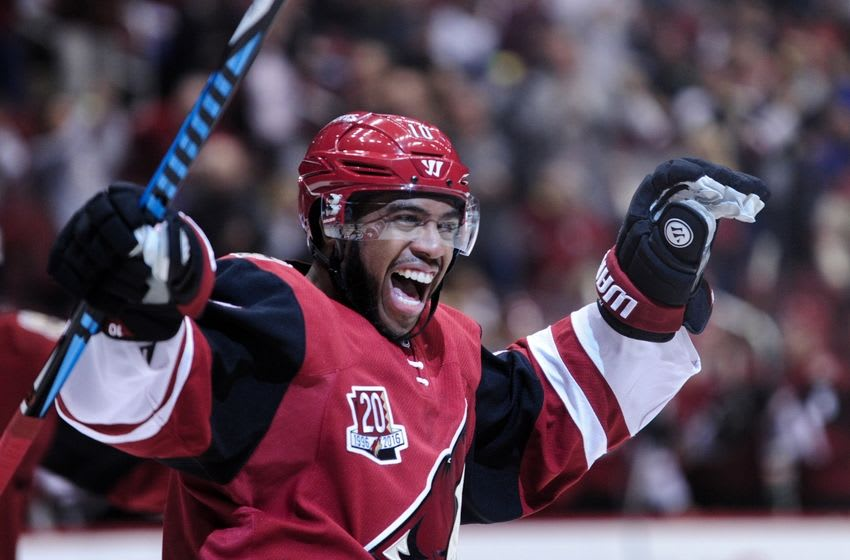 Nov 1, 2016; Glendale, AZ, USA; Arizona Coyotes left wing Anthony Duclair (10) celebrates a goal by left wing Jamie McGinn (88) during the second period against San Jose Sharks at Gila River Arena. Mandatory Credit: Matt Kartozian-USA TODAY Sports