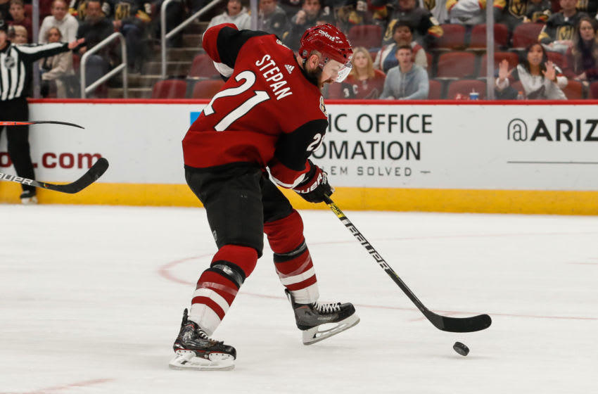 GLENDALE, AZ - OCTOBER 10: Arizona Coyotes center Derek Stepan (21) controls the puck during the NHL hockey game between the Vegas Golden Knights and the Arizona Coyotes on October 10, 2019 at Gila River Arena in Glendale, Arizona. (Photo by Kevin Abele/Icon Sportswire via Getty Images)