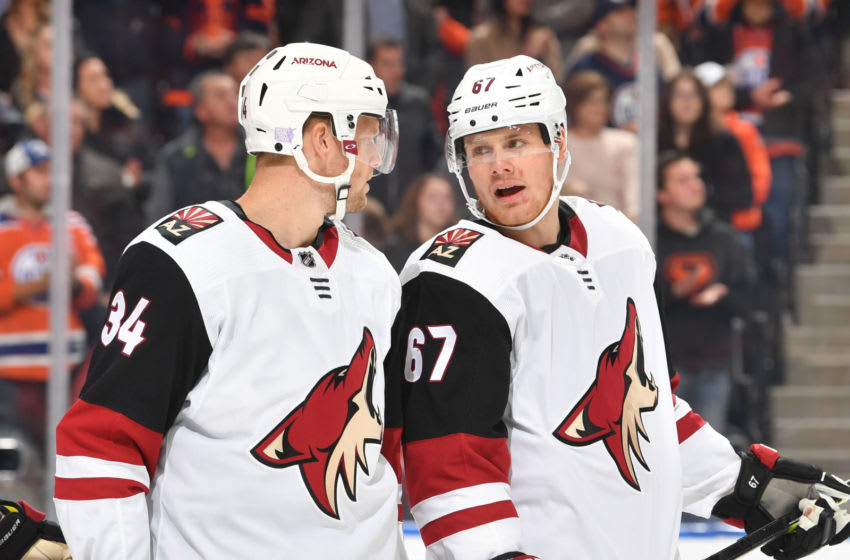 EDMONTON, AB - NOVEMBER 4: Carl Soderberg #34 and Lawson Crouse #67 of the Arizona Coyotes discuss the play during the game against the Edmonton Oilers on November 4, 2019, at Rogers Place in Edmonton, Alberta, Canada. (Photo by Andy Devlin/NHLI via Getty Images)