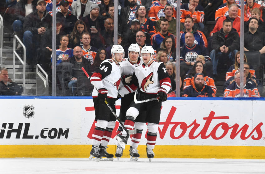 EDMONTON, AB - NOVEMBER 4: Carl Soderberg #34, Lawson Crouse #67 and Christian Fischer #36 of the Arizona Coyotes celebrate after a goal during the game against the Edmonton Oilers on November 4, 2019, at Rogers Place in Edmonton, Alberta, Canada. (Photo by Andy Devlin/NHLI via Getty Images)