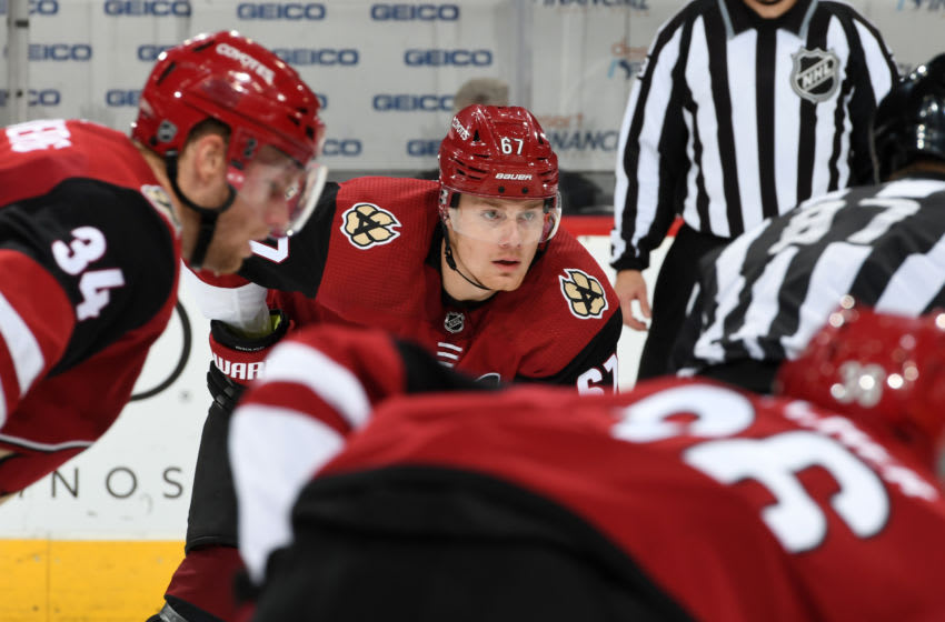 GLENDALE, ARIZONA - OCTOBER 17: Lawson Crouse #67 of the Arizona Coyotes gets ready during a face-off against the Nashville Predators at Gila River Arena on October 17, 2019 in Glendale, Arizona. (Photo by Norm Hall/NHLI via Getty Images)