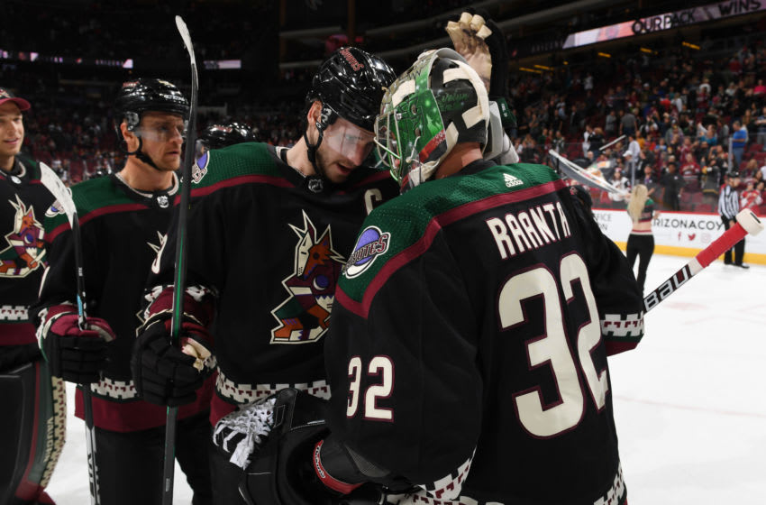 GLENDALE, ARIZONA - OCTOBER 19: Goalie Antti Raanta #32 of the Arizona Coyotes is congratulated by teammate Oliver Ekman-Larsson #23 following a 5-2 victory against the Ottawa Senators at Gila River Arena on October 19, 2019 in Glendale, Arizona. (Photo by Norm Hall/NHLI via Getty Images)