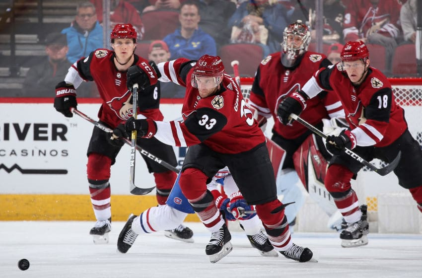 GLENDALE, ARIZONA - OCTOBER 30: Alex Goligoski #33 of the Arizona Coyotes passes the puck during the NHL game against the Montreal Canadiens at Gila River Arena on October 30, 2019 in Glendale, Arizona. The Canadiens defeated the Coyotes 4-1. (Photo by Christian Petersen/Getty Images)