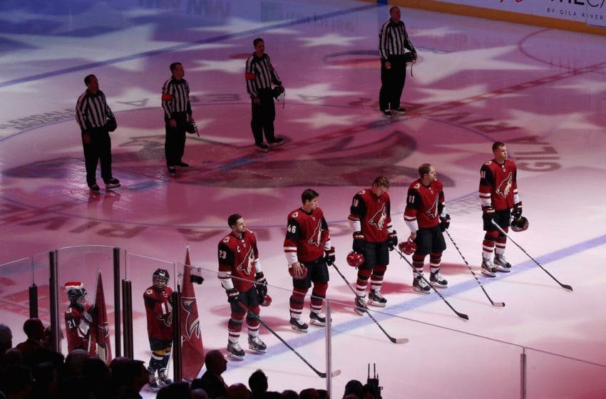 GLENDALE, ARIZONA - DECEMBER 19: The Arizona Coyotes stand for the national anthem before the NHL game against the Minnesota Wild at Gila River Arena on December 19, 2019 in Glendale, Arizona. (Photo by Christian Petersen/Getty Images)