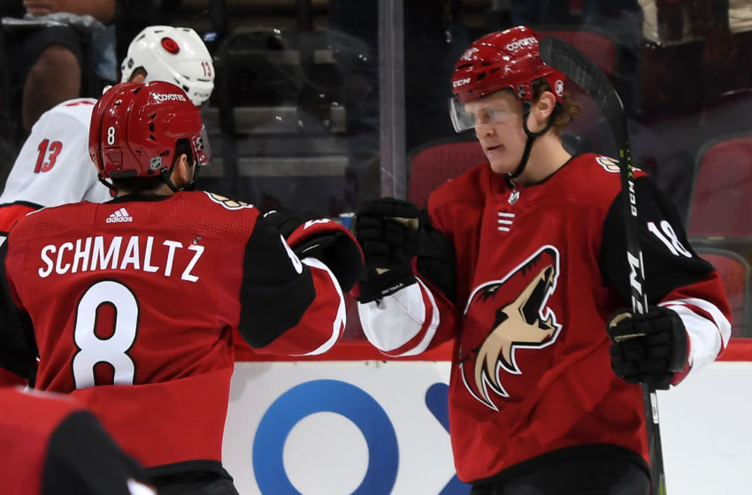 GLENDALE, ARIZONA - FEBRUARY 06: Christian Dvorak #18 of the Arizona Coyotes is congratulated by teammate Nick Schmaltz #8 of the Coyotes after scoring a goal against the Carolina Hurricanes during the second period of the NHL hockey game at Gila River Arena on February 06, 2020 in Glendale, Arizona. (Photo by Norm Hall/NHLI via Getty Images)