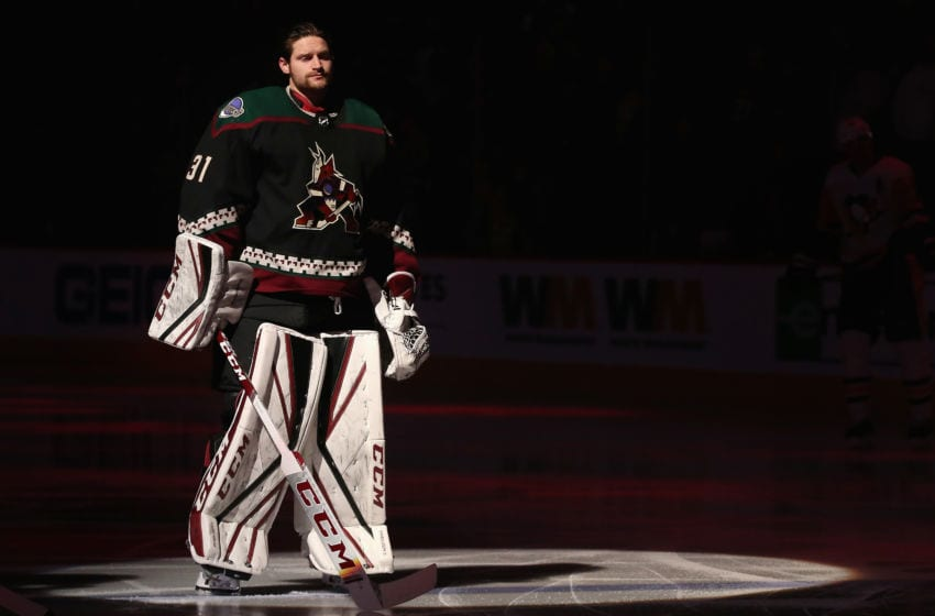 GLENDALE, ARIZONA - JANUARY 12: Goaltender Adin Hill #31 of the Arizona Coyotes is introduced before the NHL game against the Pittsburgh Penguins at Gila River Arena on January 12, 2020 in Glendale, Arizona. The Penguins defeated the Coyotes 4-3 in an overtime shootout. (Photo by Christian Petersen/Getty Images)