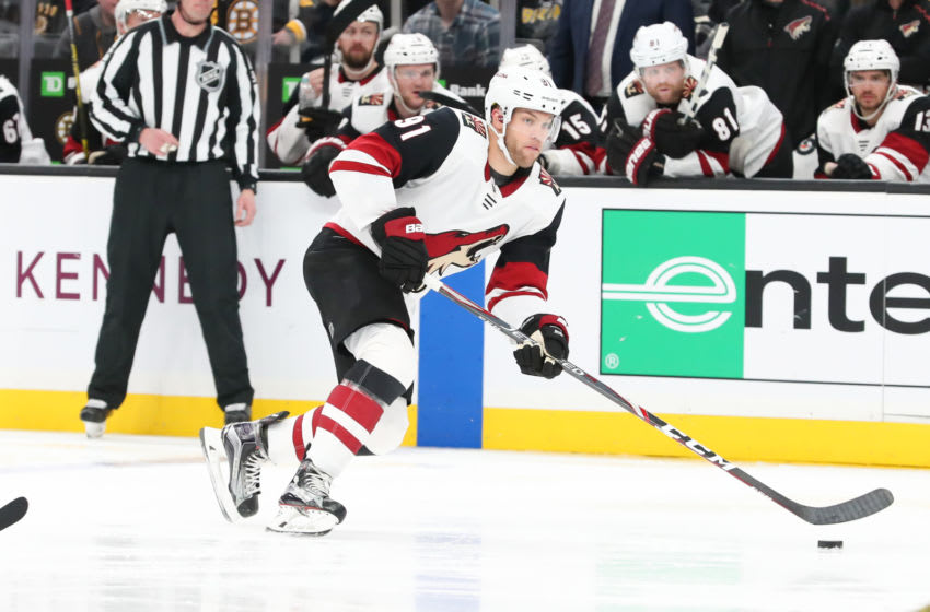 BOSTON, MA - FEBRUARY 08: Arizona Coyotes Left Wing Taylor Hall (91) moves the puck up ice during the game between Coyotes and Bruins on February 08, 2020, at TD Garden in Boston, Massachusetts.(Photo by Mark Box/Icon Sportswire via Getty Images)