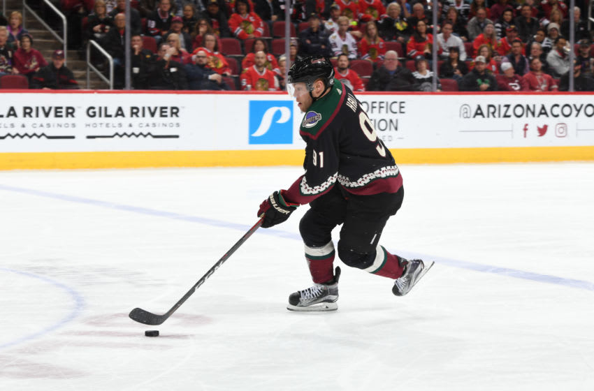 GLENDALE, ARIZONA - FEBRUARY 01: Taylor Hall #91 of the Arizona Coyotes skates the puck up ice against the Chicago Blackhawks at Gila River Arena on February 01, 2020 in Glendale, Arizona. (Photo by Norm Hall/NHLI via Getty Images)