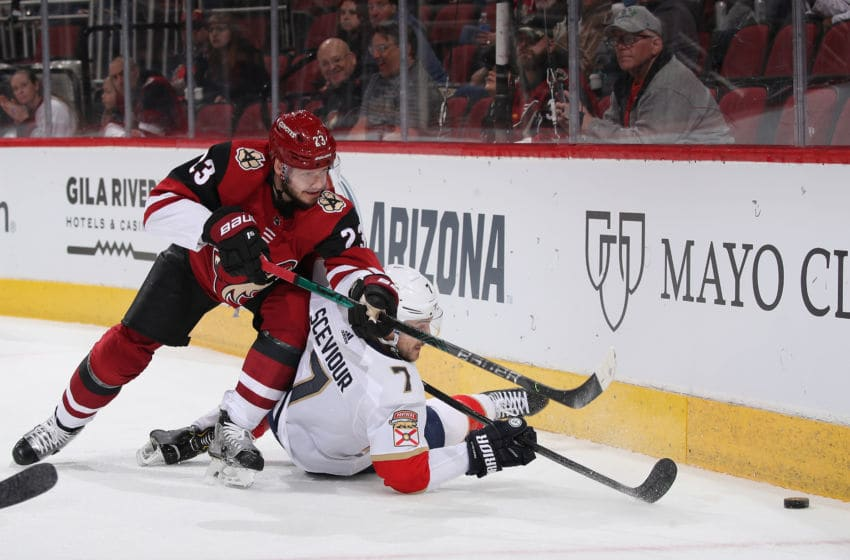 GLENDALE, ARIZONA - FEBRUARY 25: Oliver Ekman-Larsson #23 of the Arizona Coyotes and Colton Sceviour #7 of the Florida Panthers attempt to play the puck during the first period of the NHL game at Gila River Arena on February 25, 2020 in Glendale, Arizona. (Photo by Christian Petersen/Getty Images)