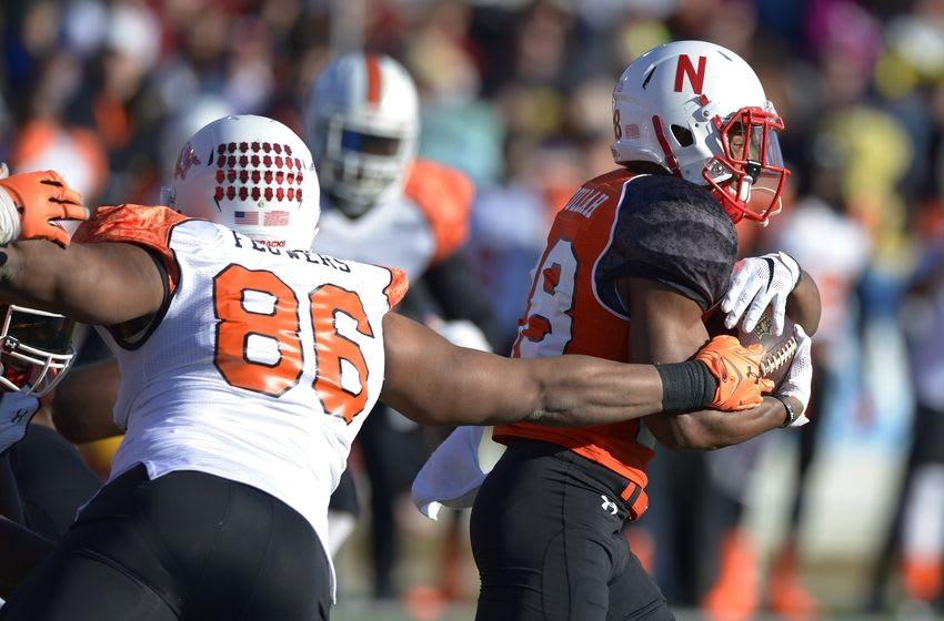 Jan 24, 2015; Mobile, AL, USA; North squad running back Ameer Abdullah of Nebraska (28) runs past the tackle attempt of South squad defensive end Trey Flowers of Arkansas (86) in the first quarter of the Senior Bowl at Ladd-Peebles Stadium. Mandatory Credit: Glenn Andrews-USA TODAY Sports