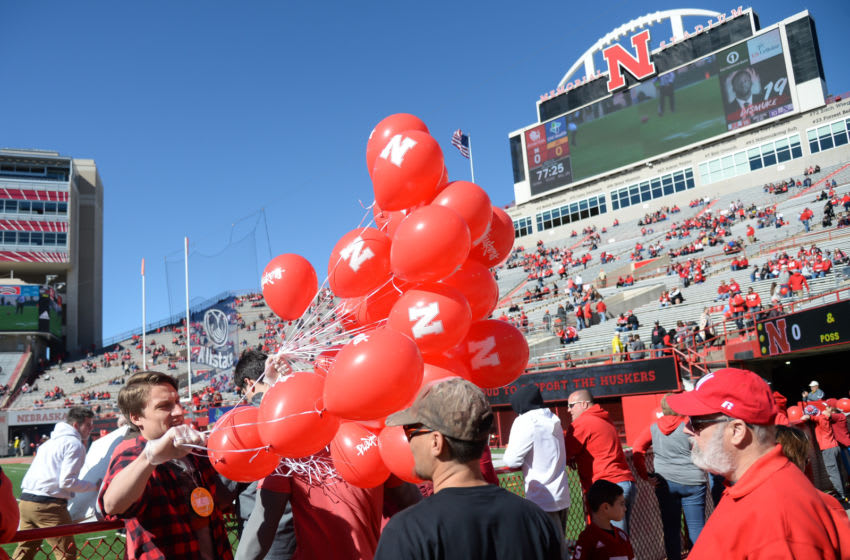 LINCOLN, NE - OCTOBER 20: Balloons are passed out before the game between the Nebraska Cornhuskers and the Minnesota Golden Gophers at Memorial Stadium on October 20, 2018 in Lincoln, Nebraska. (Photo by Steven Branscombe/Getty Images)