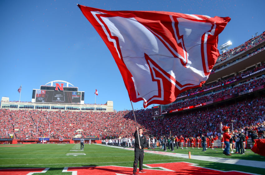 LINCOLN, NE - OCTOBER 27: A flag bearer for the Nebraska Cornhuskers waves the flag after a touchdown against the Bethune Cookman Wildcats at Memorial Stadium on October 27, 2018 in Lincoln, Nebraska. (Photo by Steven Branscombe/Getty Images)
