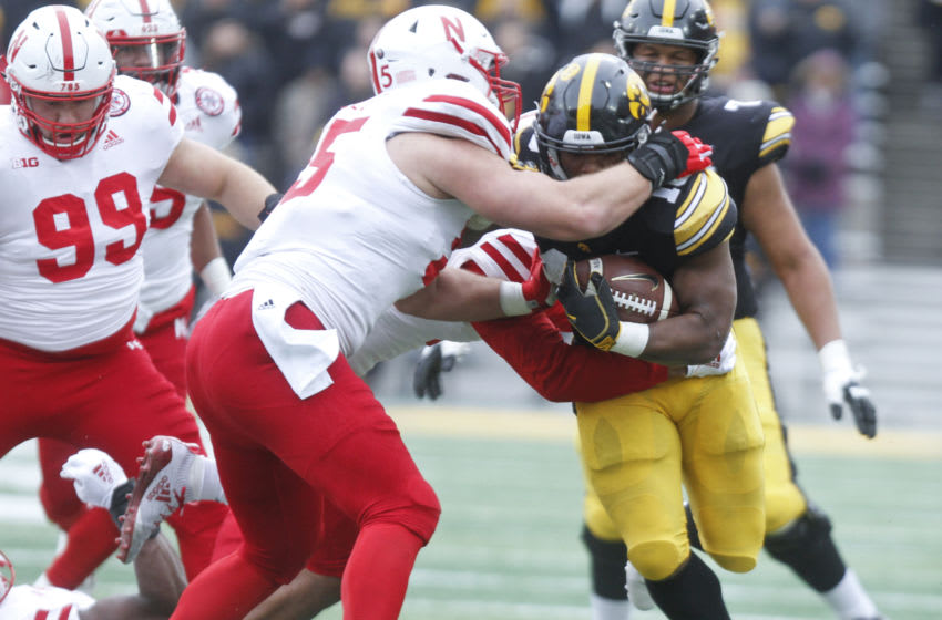 IOWA CITY, IOWA- NOVEMBER 23: Running back Mekhi Sargent #10 of the Iowa Hawkeyes is tackled during the first half by defensive lineman Ben Stille #95 of the Nebraska Cornhuskers on November 23, 2018 at Kinnick Stadium, in Iowa City, Iowa. (Photo by Matthew Holst/Getty Images)