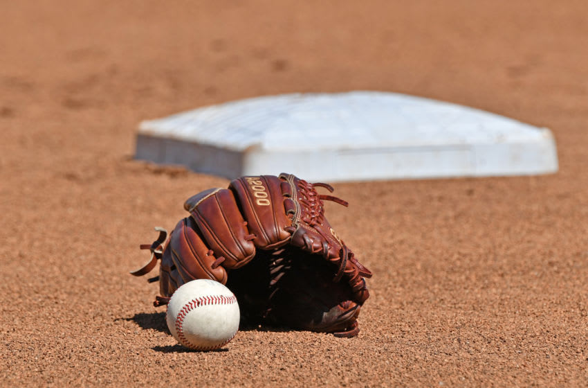 Omaha, NE - JUNE 24: A general view of a baseball and glove in the the field, prior to game one of the College World Series Championship Series between the Michigan Wolverines and Vanderbilt Commodores on June 24, 2019 at TD Ameritrade Park Omaha in Omaha, Nebraska. (Photo by Peter Aiken/Getty Images)