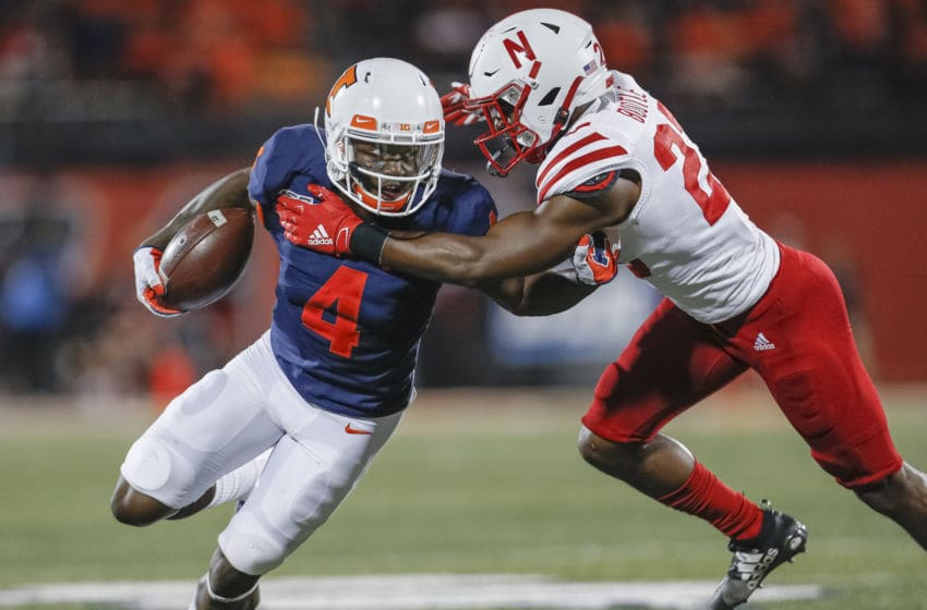 CHAMPAIGN, IL - SEPTEMBER 21: Ricky Smalling #4 of the Illinois Fighting Illini looks to turn up field as Dicaprio Bootle #23 of the Nebraska Cornhuskers looks to make the stop during the second half at Memorial Stadium on September 21, 2019 in Champaign, Illinois. (Photo by Michael Hickey/Getty Images)