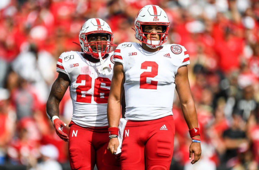 BOULDER, CO - SEPTEMBER 7: Quarterback Adrian Martinez #2 and running back Dedrick Mills #26 of the Nebraska Cornhuskers look to the sideline during the third quarter of a game against the Colorado Buffaloes at Folsom Field on September 7, 2019 in Boulder, Colorado. (Photo by Dustin Bradford/Getty Images)