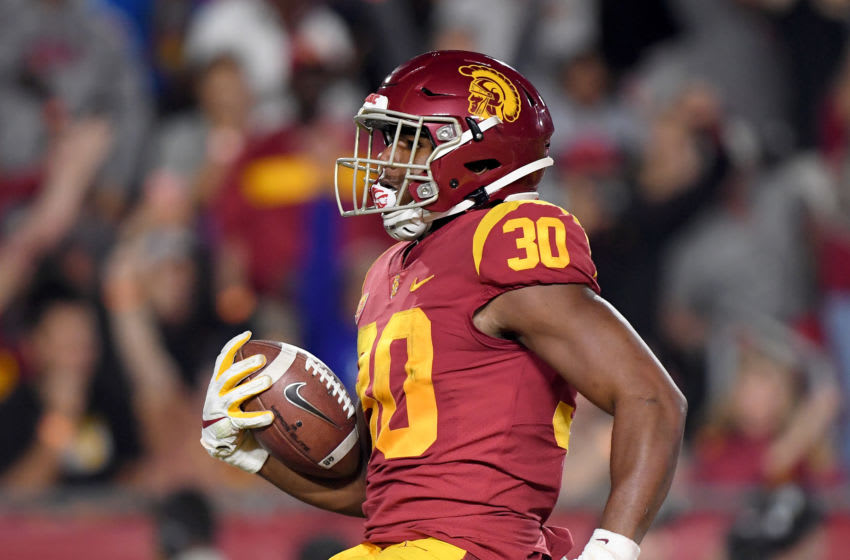 LOS ANGELES, CALIFORNIA - OCTOBER 19: Markese Stepp #30 of the USC Trojans reacts to his touchdown run, to take a 17-0 lead over the Arizona Wildcats, during the first half at Los Angeles Memorial Coliseum on October 19, 2019 in Los Angeles, California. (Photo by Harry How/Getty Images)