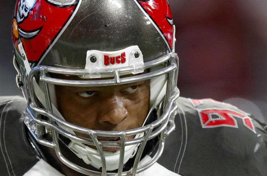 ATLANTA, GA - NOVEMBER 24: Ndamukong Suh #93 of the Tampa Bay Buccaneers reacts after scoring a touchdown in the second half of an NFL game against the Atlanta Falcons at Mercedes-Benz Stadium on November 24, 2019 in Atlanta, Georgia. (Photo by Todd Kirkland/Getty Images)