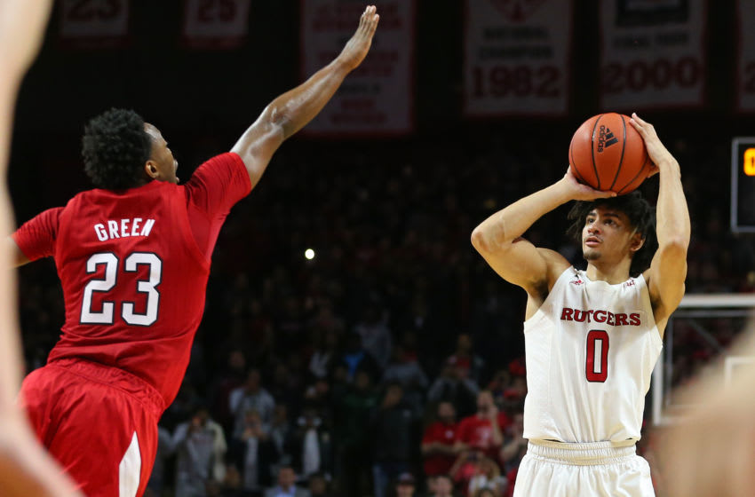 PISCATAWAY, NJ - JANUARY 25: Geo Baker #0 of the Rutgers Scarlet Knights takes a three point shot to win the game with 1.2 seconds remaining as Jervay Green #23 of the Nebraska Cornhuskers defends at Rutgers Athletic Center on January 25, 2020 in Piscataway, New Jersey. Rutgers defeated Nebraska 75-72. (Photo by Rich Schultz/Getty Images)