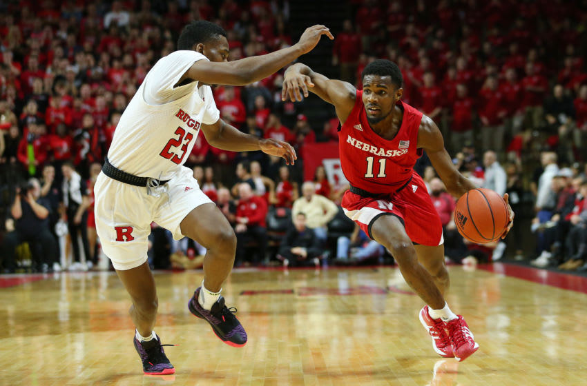 PISCATAWAY, NJ - JANUARY 25: Dachon Burke Jr. #11 of the Nebraska Cornhuskers in action against Montez Mathis #23 of the Rutgers Scarlet Knights during a college basketball game at Rutgers Athletic Center on January 25, 2020 in Piscataway, New Jersey. (Photo by Rich Schultz/Getty Images)