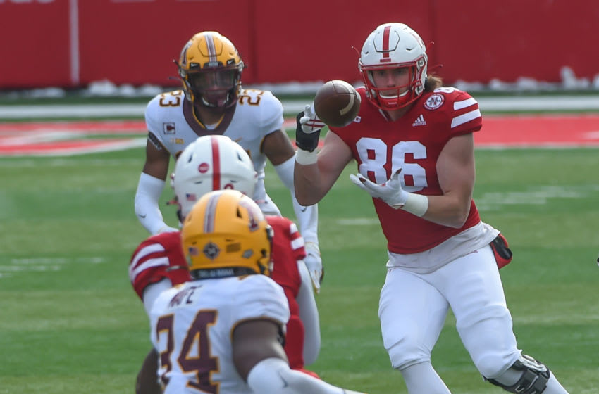 LINCOLN, NE - DECEMBER 12: Tight end Jack Stoll #86 of the Nebraska Cornhuskers catches a pass against defensive back Jordan Howden #23 of the Minnesota Golden Gophers during the first half at Memorial Stadium on December 12, 2020 in Lincoln, Nebraska. (Photo by Steven Branscombe/Getty Images)