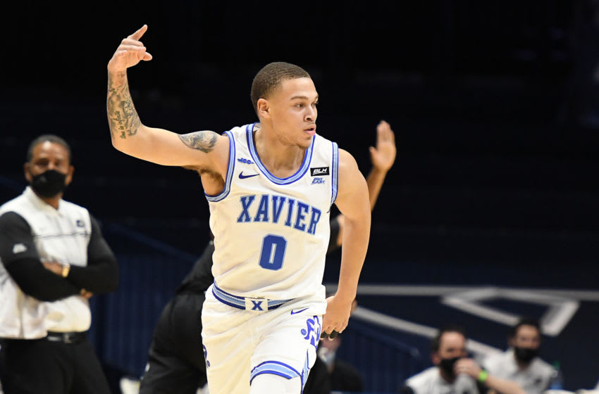 CINCINNATI, OH - JANUARY 10: C.J. Wilcher #0 of the Xavier Musketeers celebrates a shot in the first half during a college basketball game against the Providence Friars on January 10, 2021 at the Cintas Center in Cincinnati, Ohio. (Photo by Mitchell Layton/Getty Images)