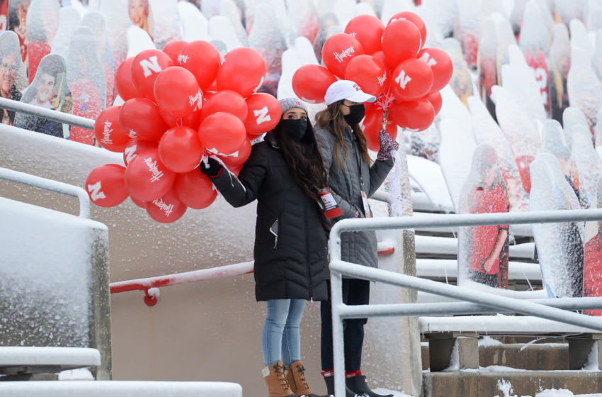 LINCOLN, NE - DECEMBER 12: Student volunteers await the first score by the Nebraska Cornhuskers when they will release the balloons in the game against the Minnesota Golden Gophers at Memorial Stadium on December 12, 2020 in Lincoln, Nebraska. (Photo by Steven Branscombe/Getty Images)