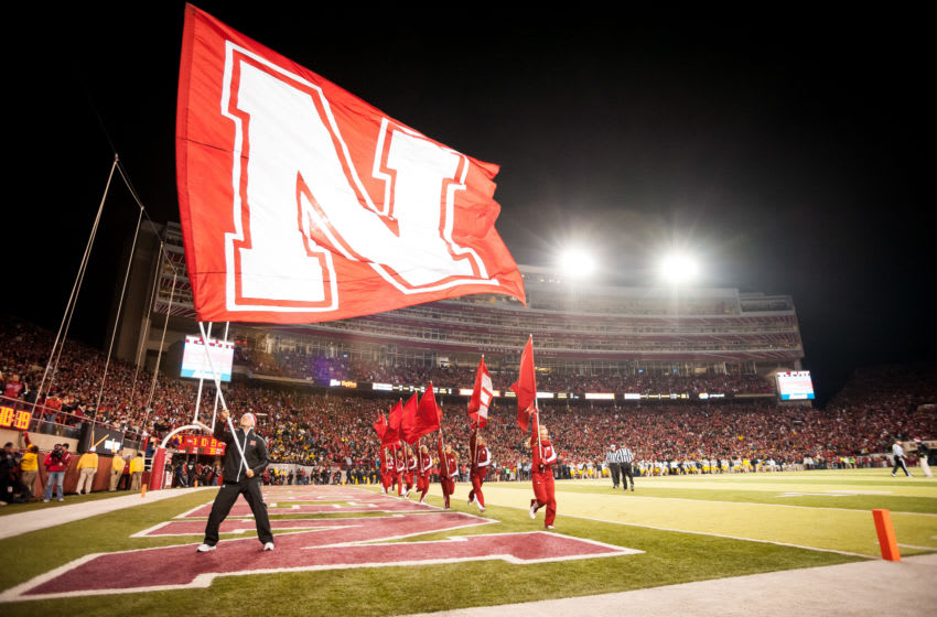 LINCOLN, NE - OCTOBER 27: A member of the Nebraska Cornhuskers cheer squad waves a flag after a touchdown during their game against the Michigan Wolverines at Memorial Stadium on October 27, 2012 in Lincoln, Nebraska. Nebraska beat Michigan 23-9. (Photo by Eric Francis/Getty Images)