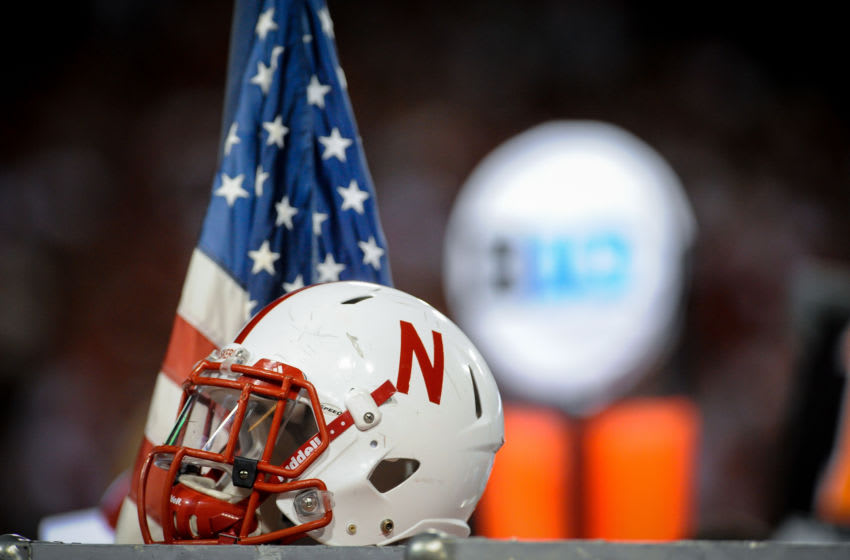 LINCOLN, NE - AUGUST 31: A Nebraska Cornhuskers helmet sits by an American flag during their game against the Wyoming Cowboys at Memorial Stadium on August 31, 2013 in Lincoln, Nebraska. Nebraska defeated Wyoming 37-34. (Photo by Eric Francis/Getty Images)