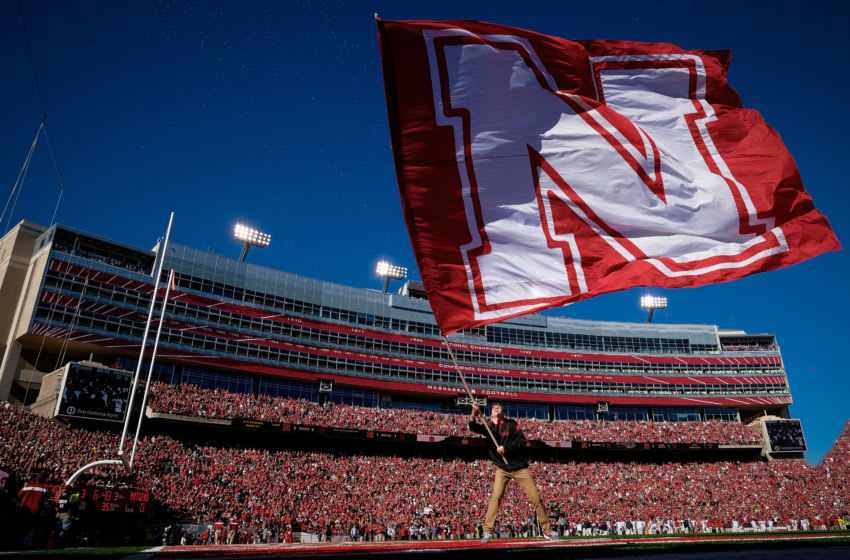 LINCOLN, NE - OCTOBER 25: A flag bearer for the Nebraska Cornhuskers waves a flag after the first score during the game against the Rutgers Scarlet Knights at Memorial Stadium on October 25, 2014 in Lincoln, Nebraska. Nebraska defeated Rutgers 42-24. (Photo by Eric Francis/Getty Images)