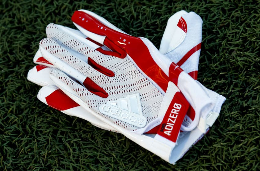 CHAMPAIGN, IL - SEPTEMBER 29: A pair of Nebraska Cornhuskers Adidas gloves is seen on the field before the game at Memorial Stadium on September 29, 2017 in Champaign, Illinois. (Photo by Michael Hickey/Getty Images)