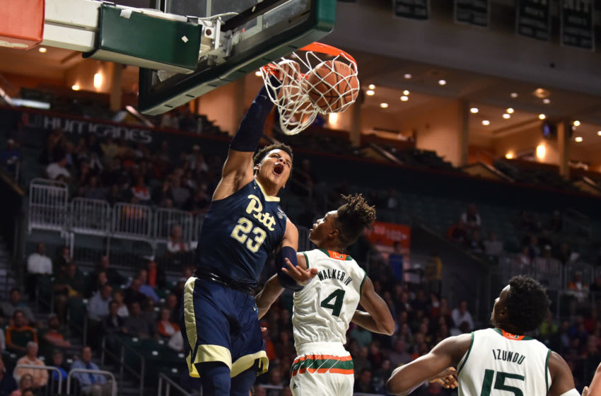 MIAMI, FL - JANUARY 31: Shamiel Stevenson #23 of the Pittsburgh Panthers dunks the basketball while being defended by Lonnie Walker IV #4 of the Miami Hurricanes during the first half of the game at The Watsco Center on January 31, 2018 in Miami, Florida. (Photo by Eric Espada/Getty Images)