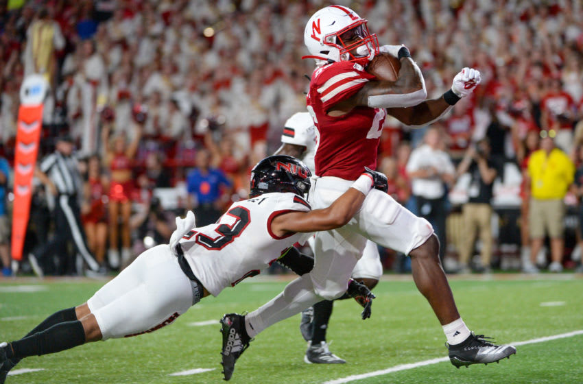 LINCOLN, NE - SEPTEMBER 14: Running back Dedrick Mills #26 of the Nebraska Cornhuskers drags cornerback Jalen McKie #23 of the Northern Illinois Huskies in the end zone for a touchdown in the first half at Memorial Stadium on September 14, 2019 in Lincoln, Nebraska. (Photo by Steven Branscombe/Getty Images)