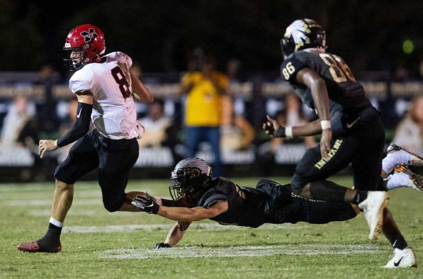 Muscle Shoals' Logan Smothers (8) carries against Wetumpka at Hohenberg Stadium in Wetumpka, Ala., on Friday October 25, 2019. Wet14
